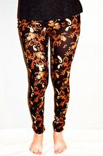 Ladies/Womens Orange Paisley patterned leggings on a brown background