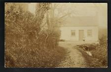 ? Aberystwyth area. Girl with Stream & House.