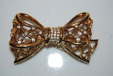 VINTAGE SWAROVSKI SWAN LARGE GOLD TONED METAL BOW WITH RHINESTONES PIN OR BROOCH