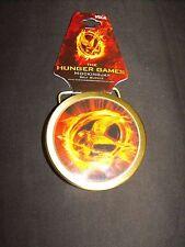 HUNGER GAMES MOCKINGJAY BELT BUCKLE NEW NECA 2012 LIONS GATE FILMS INC. L@@K