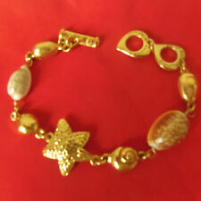 """YVES SAINT LAURENT bracelet vintage """"étoile et coquillages """" signé et numéroté"""