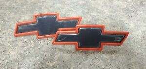 SET OF 2 - NEW NOS OEM Chevrolet Bow Tie Emblems Black and Red