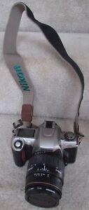 Nikon N65 35mm SLR Camera Package 2 Quantaray Lenses, Film, Bag