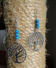 Boucle d'oreille arbre de vie cercle argent et perles de bois. Bijou fait main