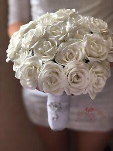 Handmade wedding bouquet. White wedding bouquet.