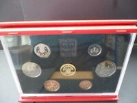 1991 PROOF COIN SET IN ROYAL MINT RED LEATHER DELUXE CASE WITH LEAFLET AND BOX.
