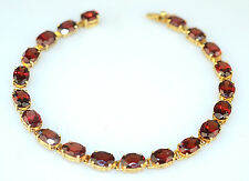14K YELLOW GOLD 10 CARAT OVAL GARNET TENNIS BRACELET 7 INCHES LONG 8.7 GRAMS