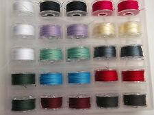 **25 Sewing machine Bobbins loaded with quality thread + storage case. Option K