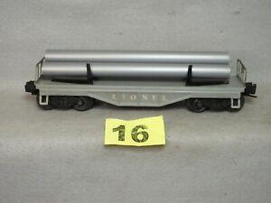 LIONEL O GAUGE #6111 SHEET METAL FLATCAR W/GRAY PIPES, VERY GOOD, READY TO RUN