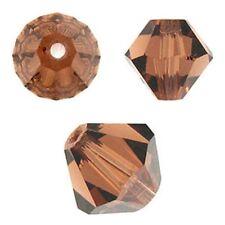 Swarovski Crystal Bicone. Smoked Topaz Color. 3mm. Approx. 144 PCS. 5328