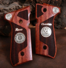 Beretta 92FS grips made from Rosewood with your designs made of silver.