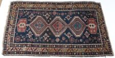 Antique Caucasian Rug, geometric patterns, wool pile, in reds, tans, dark blues