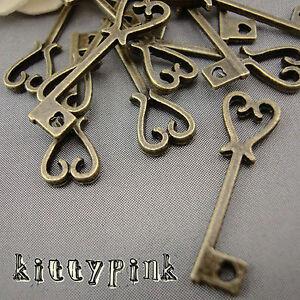 10 Antique Bronze Alice in wonderland Heart Key Charms Steampunk DIY