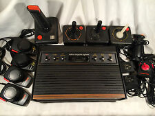Atari 2600 Woodgrain Console, 6 Switch, W/ Extra Controllers and Parts - TESTED