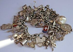 Amazing vintage solid silver charm bracelet & 37 charms,rare,open.move.107.4g