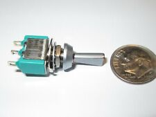 EATON  MINIATURE FLAT TOGGLE SWITCH  SPDT ON-OFF-(ON)  PANEL MOUNT  NOS 1 PCS.