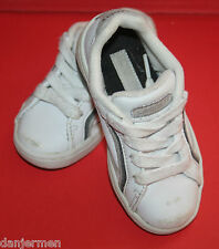 Children's white, lace up sports style shoes by Lacoste. Size 6.