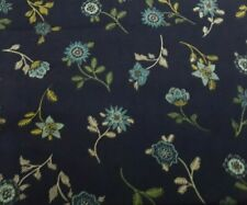 Black background with green, teal, yellow flowers. Andover Fabrics