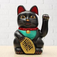 Chat porte-bonheur maneki-neko Japonais noir Feng shui richesse bonne fortune