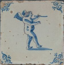 Nice Dutch Delft Blue tile, Amor with flute, mid 17th century.