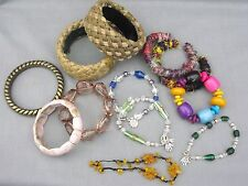 A Mixed Lot of Vintage 12 bangles and bracelets - amber glass rope acryllic