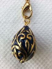 Dark blue enamel Easter egg pendant with goldtone overlay design
