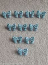 10 x BLUE BOW SHAPED BUTTONS size approx 16mm x 10mm ~CHILDREN/FASHION/CRAFT