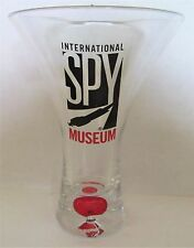 "INTERNATIONAL SPY MUSEUM 4 1/4"" TALL FLUTED SHOT GLASS RED BUBBLE BASE"