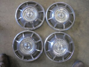 (4) 1960-1969 Chevrolet Corvair 13 Inch Hubcaps Rat Rod Wall Hanger O.E.M. Used.