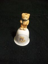 Collectible ceramic bell with a brown bear with a blue scarf as handle