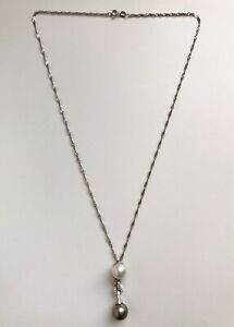 18 Carat White Gold Pearl And Diamond Articulated Pendant