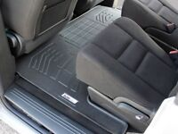 Second Row Black Floor Mat for a 2008 - 2018 Dodge Grand Caravan