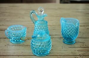 Children's Fenton  dishes to include 2 creamers, honey/jelly jar, and cruet