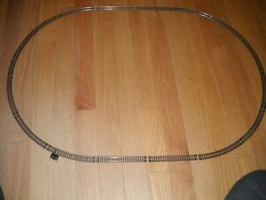"""N SCALE SET OF OVAL TRAIN TRACK ABOUT 30""x20"" WITH TERMINAL RERAILER TRACK"