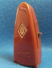 VINTAGE METRONOME TAKTELL, PORTABLE PENGUIN-LIKE. BROWN PLASTIC. WEST GERMANY.