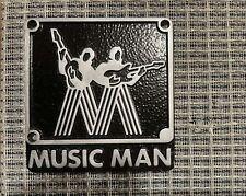 Music Man logo badge MOLDED RESIN Black background Silver letters Large size