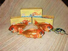 144 Stück Wal frisst kleinen Fisch aus Blech im Originalkarton aus China ca.16cm