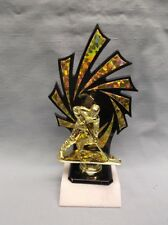 gold male ice hockey trophy black gold backdrop on marble base