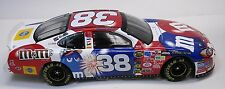 1:24 ACTION 2004 #38 M&M'S 4TH OF JULY RED WHITE AND BLUE TAURUS ELLIOTT SADLER