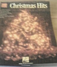 Christmas Hits for Easy Guitar with Notes and Tabulature by Hal Leonard