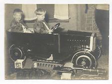 2 CHILDREN w/ IRON TRAIN, TIN TRAIN, PEDAL CAR, BLOCKS, BABY SQUEEZE TOY PHOTO