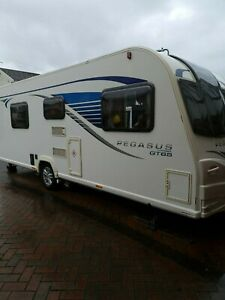 Bailey Pegasus GT65  Rimini 4 Berth fixed twin bed caravan with motor mover.