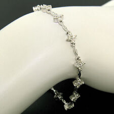 18K White Gold 1.65ctw Diamond Flower Cluster Twisted Wire Link Tennis Bracelet