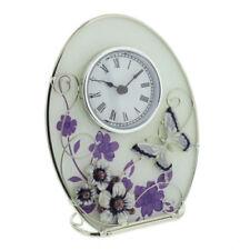 Relojes de escritorio y chimenea de cristal