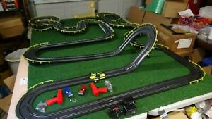 Artin Thunder Road 1/43 rd Slot set  2 Trucks Over 46 feet You CAN'T Touch this!