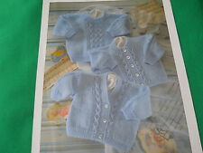 Childs sweater and cardigans 16 to 22 ins knitting pattern