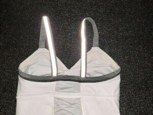 Lululemon Light Up Reflective Running Tank Top Size 6 Pink Gray Pocket Cycling