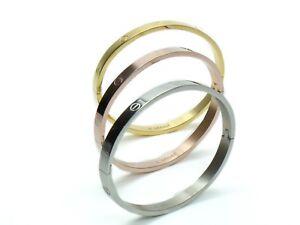Bracciale rigido tubolare contrari\u00e8 chiodo placcato oro giallo in argento 925\u2030