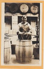 Real Photo Postcard RPPC - Man Sitting in Barrel - Whiskey Boxes