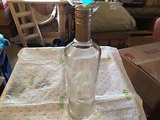 Clear glass  empty Seagrams vodka bottle